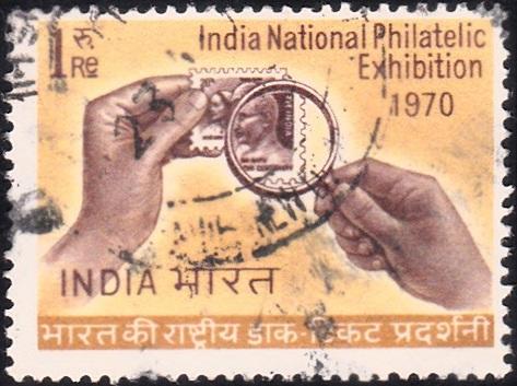Hands Holding Magnifier on Gandhi (1969) Stamp