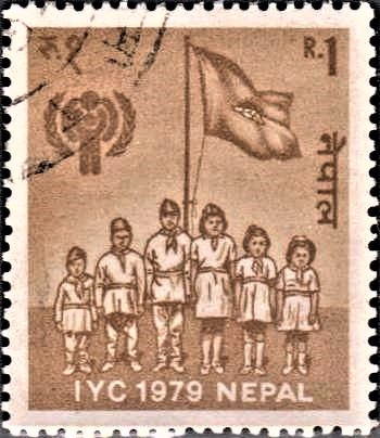 Children with Flag and IYC Emblem