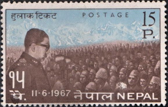 King Mahendra addressing Nepali Crowd and Himalayas