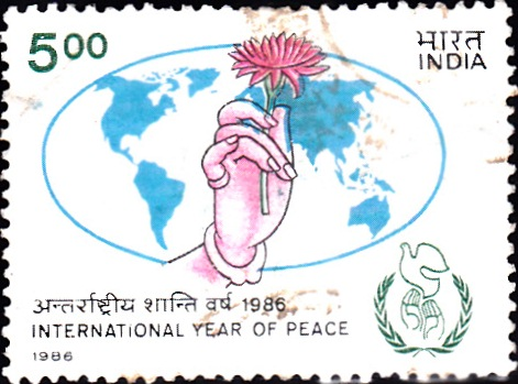 Hand Holding Lotus, Peace Dove & World Map