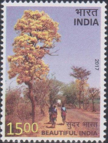 Tree with yellow flowers and Indian girls going to school